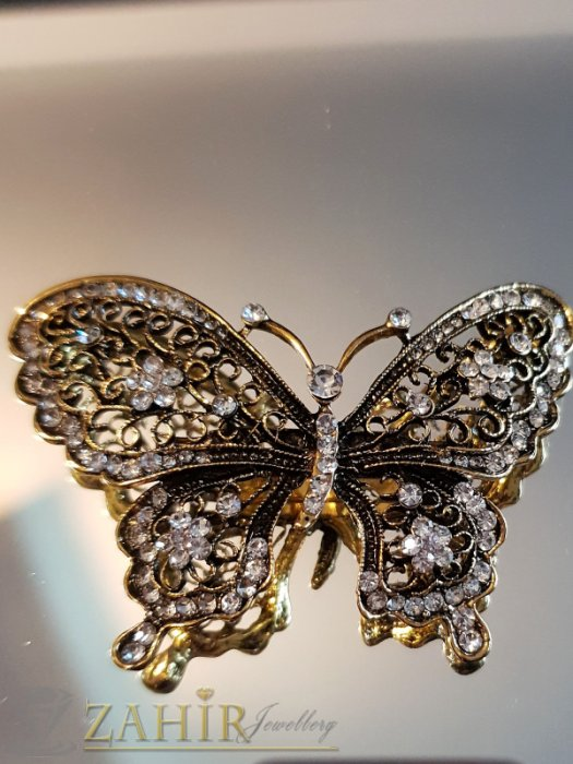 Дамски бижута - Фино изработена златиста брошка пеперуда 7 на 4 см с многобройни бели кристалчета - B1117