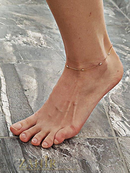 Дамски бижута - Нежна гривна за крак 23 + 5 см с метални елементи и златно покритие - GK1065
