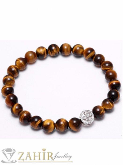 Дамски бижута - Ластична гривна от тигрово око 8 мм със кръст с ковани кристали в 2 цвята, 7 размера - MGA1360
