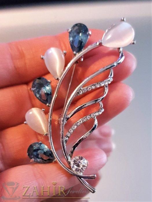 Дамски бижута - Изящно изработена брошка 7 на 3 см, с бели и сини кристали, сребърно покритие - B1179