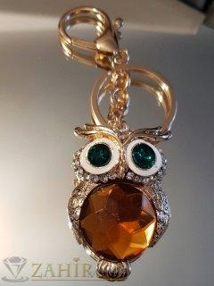 Ключодържател 11 см с кристална сова 5 см със зелени очи и голям фасетиран кехлибарен кристал, позлатен - KL1050